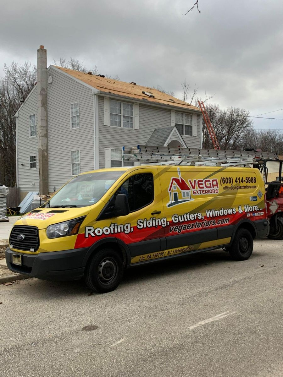 Vega Exteriors Van in Front of Roof Replacement Project